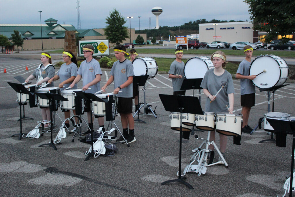 Drumline members from the Marching Monarchs play on TV to kick off to the 2019 football season.