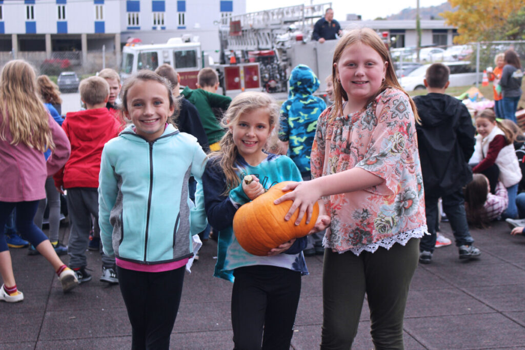 Pictured from left: The pumpkin of 3rd grade students Chloe Weekley, Lennon Gamble and Kenzie Lyseski was one of the few pumpkins to survive the fall on Friday.