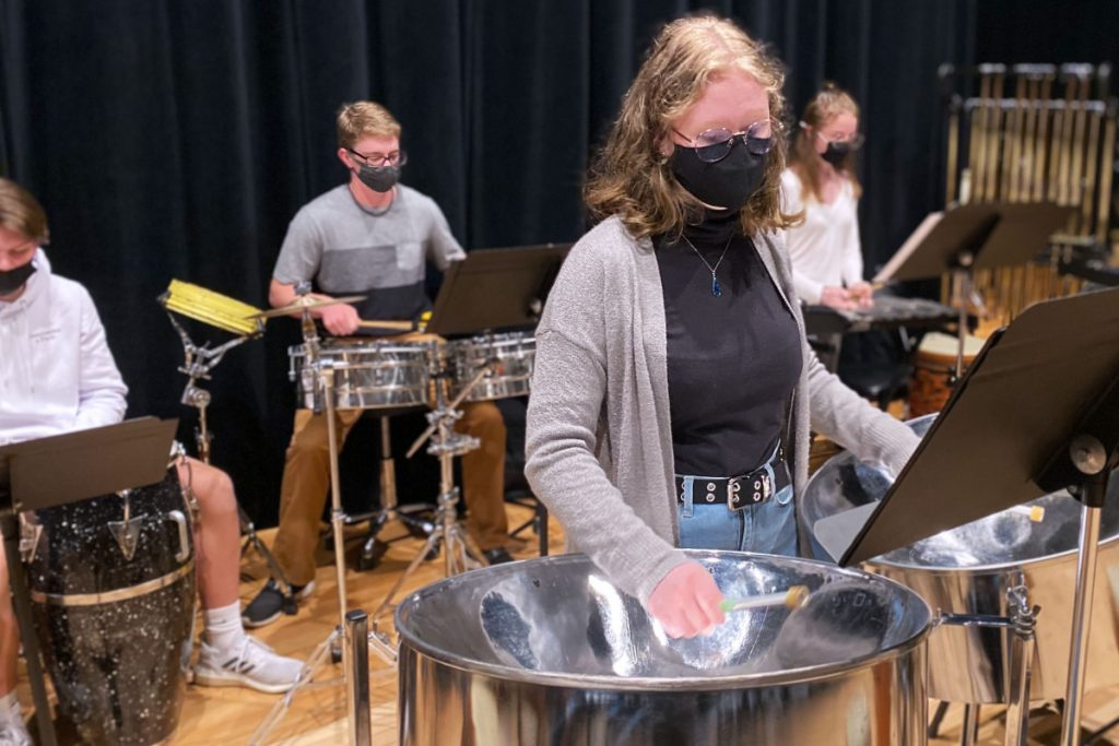 Paige Wallace, center, and other members of the JMHS Percussion ensemble rehearse for Thursday's concert.