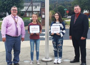Pictured from left: JM Assistant Principal Geno Polsinelli, Cameron McCord, Mariah Lehman and K of C Council 1907 Grand Knight Lou Richmond. Not Pictured: Ethan Merritt.