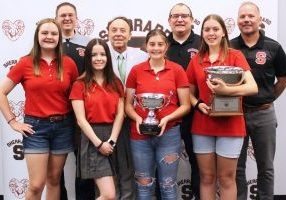 Randall Reid-Smith, curator for the West Virginia Department of Arts, Culture and History, presented the 2020 WV History Bowl champions at SMS with a trophy during a presentation at the school on Wednesday afternoon. Pictured from left front row: Lilly Roman, Payton Hill, Alexis (A.C.) Cumberledge and Grace Gatts. Back row from left: SMS Coach Jeffrey Stephens, Curator Randall Reid-Smith, Coach Dan Gatts and SMS Principal Jason Marling.