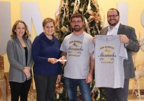 Owner of Fabtabulous Custom Apparel Chuck Loy has donated $800 to one of John Marshall High School's most charitable organizations, Paws for a Cause.