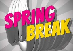 The words Spring (in pink) Break (in yellow) overtop of a grey background write